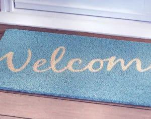 welcome mat in front of door